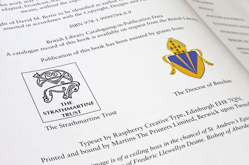 Strathmartine Trust logo inside a book